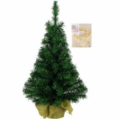 Volle kerstboom in jute zak 60 cm inclusief warm witte kerstverlichting